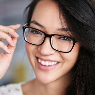 Young woman wearing a new pair of prescription glasses